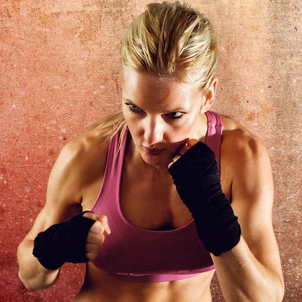 Mixed Martial Arts Lessons for Adults in Woburn MA - Lady Kickboxing Focused Background