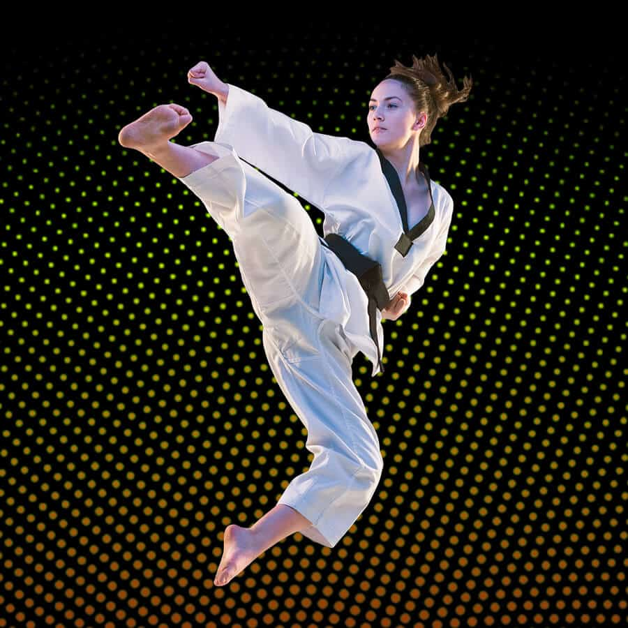 Martial Arts Lessons for Adults in Woburn MA - Girl Black Belt Jumping High Kick