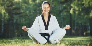 Martial Arts Lessons for Adults in Woburn MA - Happy Woman Meditated Sitting Background